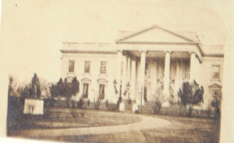 Recently discovered and published Warren photo taken on March 6, 1865. The image shows the White House. However when closely inspected, an image of a tall bearded man can be seen. Experts are 'cautiously optomistic' about the possibility that this is Abraham Lincoln.