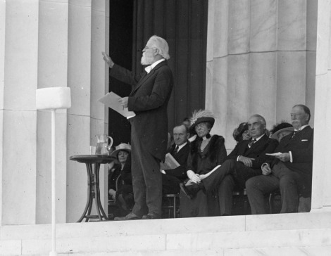 Poet Edwin Markham reads a verse to the crowd at the Dedication Celebration. Behind him sits Vice President Calvin Coolidge, President Warren Harding and Chief Justice William Howard Taft.