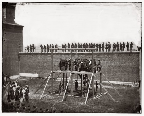 "Alexander Gardner's photograph ""Arrival at Scaffold"" with William Coxshall beneath the gallows on the front left side."