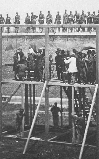 Four conspirators in the Lincoln assassination are prepared for hanging on July 7, 1865.