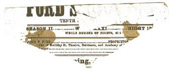 A corner of a bloodstained playbill taken from Ford's Theatre on the night of Lincoln's assassination, April 14, 1865.