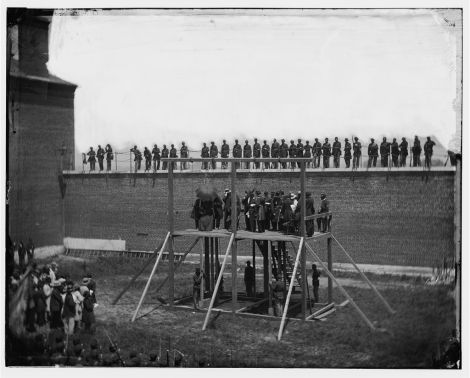 The Lincoln conspirators are prepared for execution at the Washington Arsenal Penitentiary on July 7, 1865.